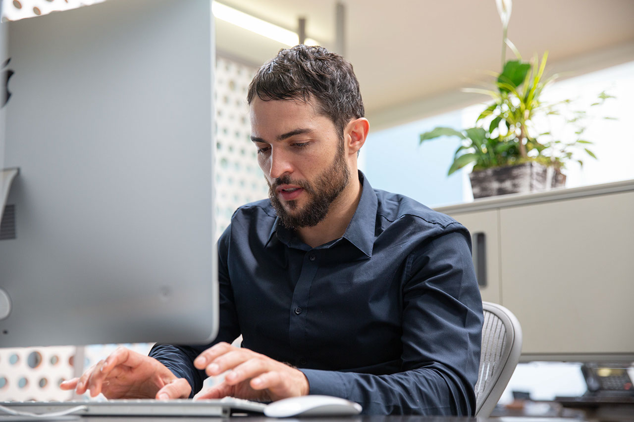 Man in office working on computer