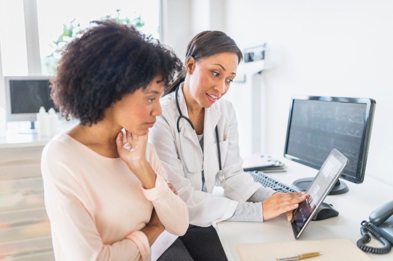 Provider and patient looking at results on tablet